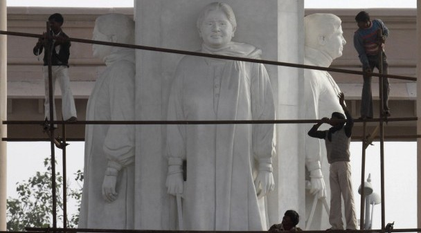 Workers erect scaffolding to cover statues of Uttar Pradesh Chief Minister Mayawati in Lucknow. (Photo: Reuters)