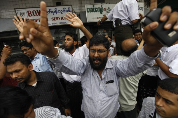 Muslim leaders talk to protesters near Sule Pagoda in Rangoon on June 5. (Photo: Reuters)