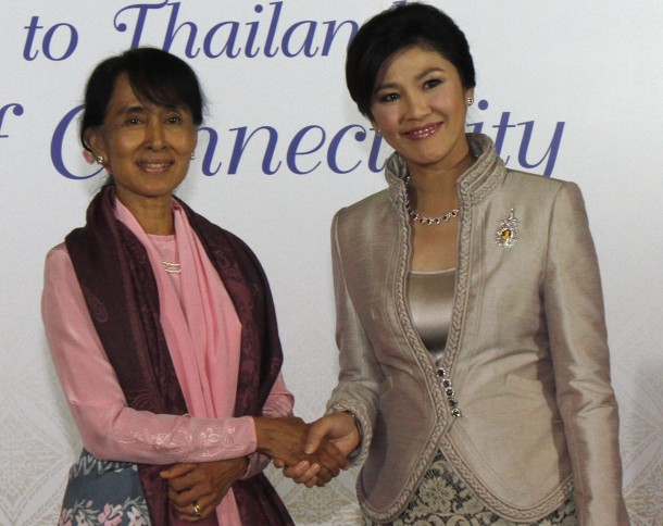 Aung San Suu Kyi, right, shakes hands with Thai Prime Minister Yingluck Shinawatra before a gala-dinner for World Economic Forum on East Asia in Bangkok. (Photo: Reuters)