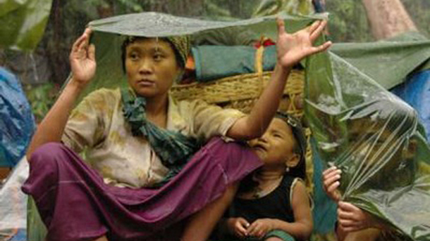 An IDP family shelters from the rain in the Karen jungle. (Photo: Free Burma Rangers)