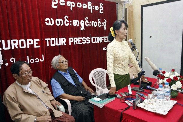 Aung San Suu Kyi speaks at a press conference at the NLD headquarters in Rangoon on July 3. (Photo: The Irrawaddy)
