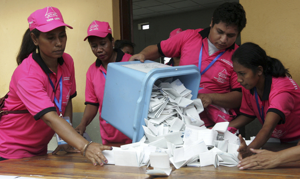 East Timor's election commission volunteers count ballots in a polling station during parliamentary elections in Dili. (PHOTO: Reuters)