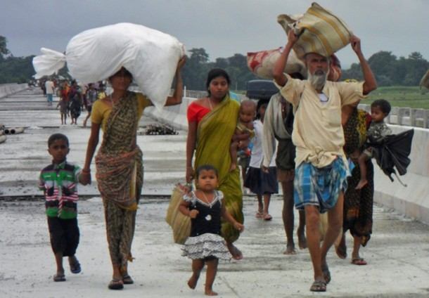 Villagers carry their belongings to relief camps after violence at Chirang District in the northeastern Indian state of Assam last month. (Photo: Reuters)