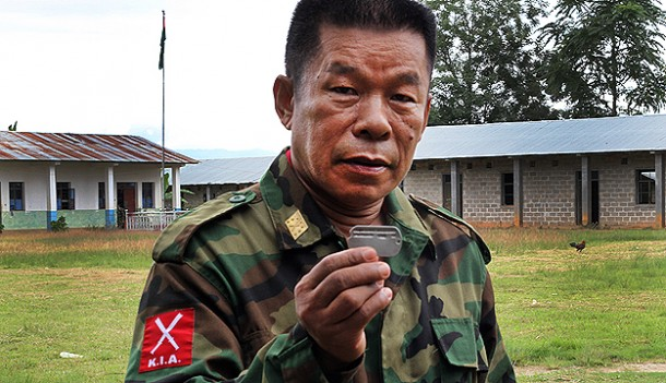 Maj Zau Seng of the Kachin Independence Army holds the dog tag of US airman Cleveland Hargrove. (Photo: Seamus Martov / The Irrawaddy)
