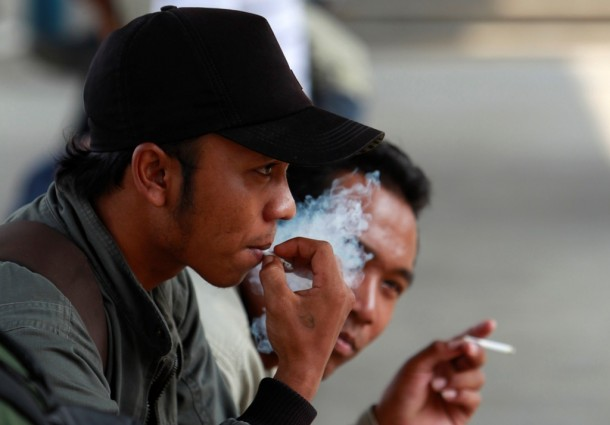 Men smoke cigarettes at a railway station in Jakarta, Indonesia, in May. (Photo: Reuters)