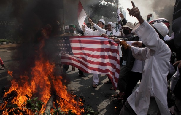 Indonesian Muslim protesters burn a US flag during a protest in Jakarta on Monday. (Photo: Reuters)