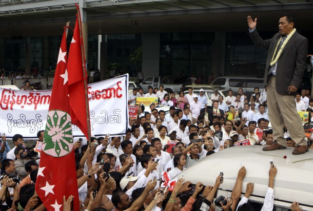 Moe The Zun addresses a crowd from atop a van outside Rangoon International Airport on Saturday. (Photo: The Irrawaddy)