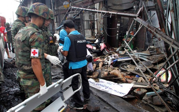 Police officers inspect the site of a car bomb attack in southern Thailand's Sai Buri District in Pattani Province on Friday. (Photo: Reuters)