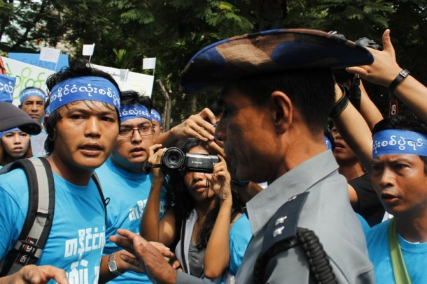 Peace protesters are confronted by security forces at People's Square in Rangoon. (Photo: Hpyo Wai Tha / The Irrawaddy)