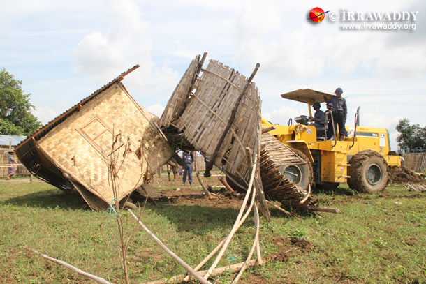 A bulldozer destroys a house on the disputed land in Mandalay on Monday. (Photo: The Irrawaddy)