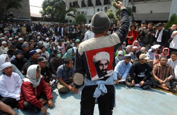 A supporter of Indonesian militant cleric Abu Bakar Bashir rallies other supporters outside a court at South Jakarta on June 16, 2011. Bashir was jailed for 15 years for his involvement with a group that aimed to kill the country's president. (PHOTO: Reuters)