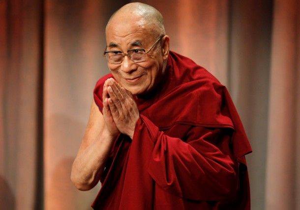 Tibet's exiled spiritual leader the Dalai Lama greets an audience in Boston. (Photo: Reuters)