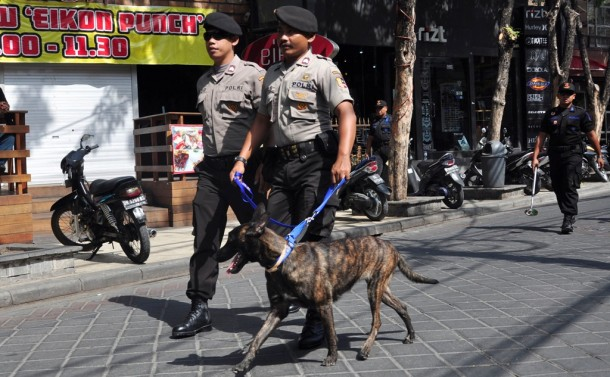Police officers and a sniffer dog patrol in Indonesia. (Photo: Reuters)Police officers and a sniffer dog patrol in Indonesia. (Photo: Reuters)