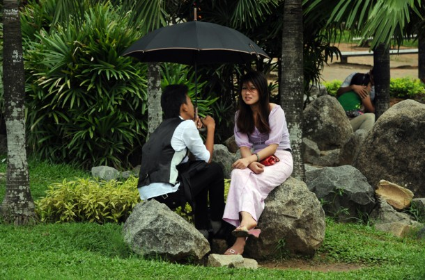 Umbrellas are a must for many couples in Rangoon. (Photo: Steve Tickner / The Irrawaddy)
