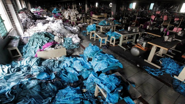 Clothes and sewing machines are seen in the Tazreen Fashions garment factory, where 112 workers died in a fire, in Savar, Bangladesh. (Photo: Reuters)
