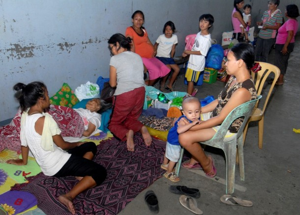 Residents take temporary shelter at an evacuation center ahead of Typhoon Bopha in Cagayan de Oro City, southern Philippines. (Photo: Reuters)