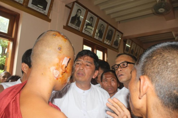 88 Generation Students group leaders Min Ko Naing, Ko Ko Gyi and Mya Aye, left to right, speak to an injured monk in Monywa. (Photo: 88 Gen)