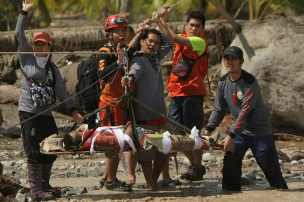 Rescuers evacuate Carlos Agang who was found alive after Typhoon Bopha in New Bataan town in the southern Philippines. (Photo: Reuters)