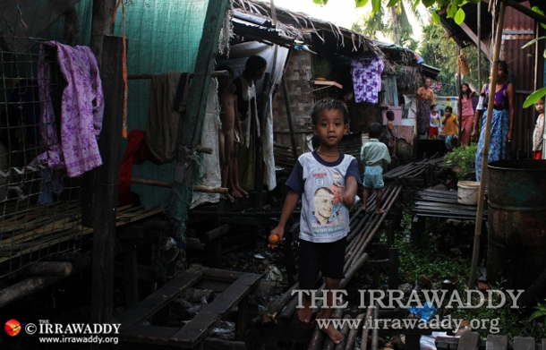 A young boy in the Takata slum in Rangoon. (Photo: JPaing / The Irrawaddy)