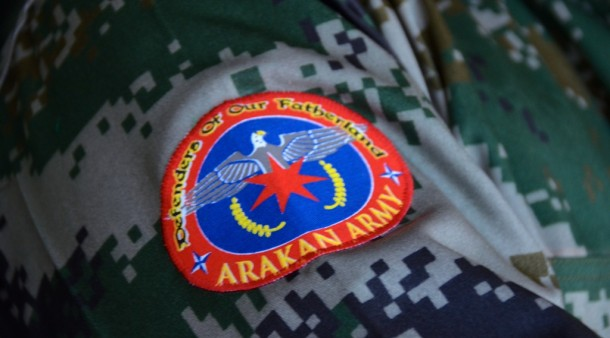 The Arakan Army logo shows an osprey half-covered with a red seven-pointed star, with two NATO-logo-like four-pointed stars on either side. (Photo: Simon Roughneen / The Irrawaddy)