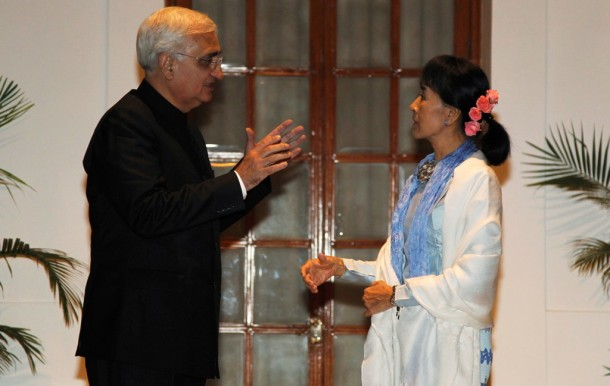 India's External Affairs Minister Salman Khurshid, left, speaks with Burmese opposition leader Aung San Suu Kyi in New Delhi during her visit to India in November. (Photo: Reuters)