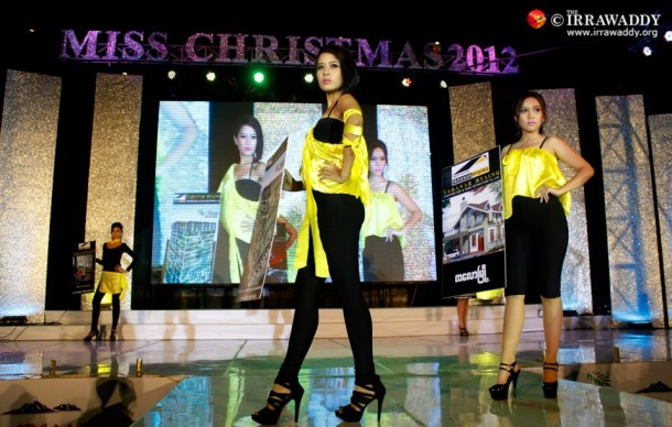 "Models appear on the stage at the ""Miss Christmas 2012"" event at the Chatrium Hotel in Rangoon. (Photo: Jpaing / The Irrawaddy)"