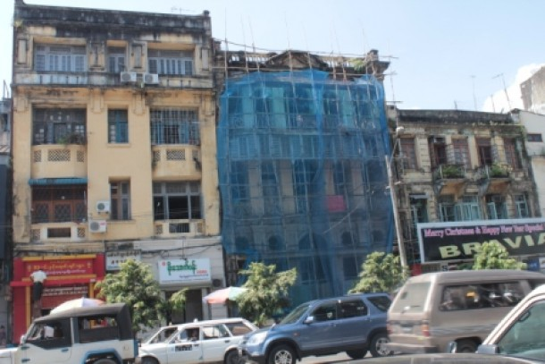 The old building at 233-235 Pansodan Street in Rangoon, center, that was about to be demolished by the local authorities. (Photo: Nang Nom / The Irrawaddy)