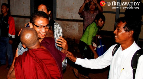 Famous dissident Gambira embraces a Buddhist monk after his release from Rangoon's Insein Prison on Monday. (Photo: JPaing / The Irrawaddy)