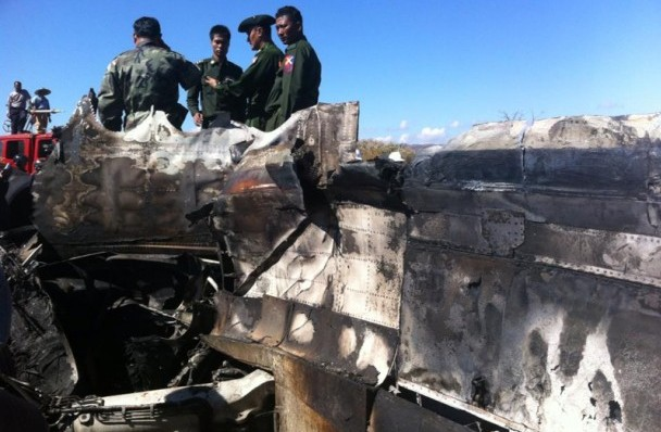 Burmese soldiers inspect the wreckage of an Air Bagan Fokker-100 that crashed near Heho, Shan State, on Dec. 25. (Photo: Khit / The Irrawaddy)