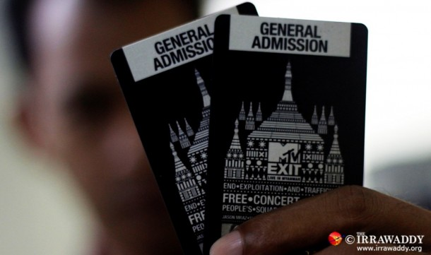 A Burmese music fan holds up a pair of tickets for the MTV EXIT free concert on Dec. 16 that will feature American pop star Jason Mraz. (Photo: Jpaing / The Irrawaddy)