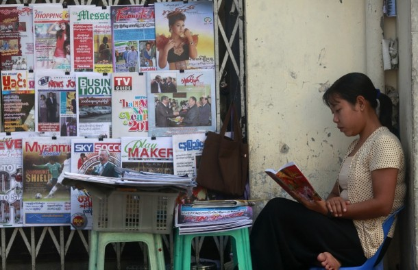 A woman sells newspapers and journals in Rangoon in December 2011. Burma's government announced on Tuesday that private daily newspapers could return to the market in April 2012. (Photo: Reuters)