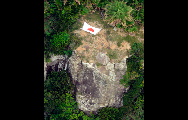 Aerial photo from Kyodo News shows Japan's national flag on one of a group of disputed islands known as Senkaku in Japan and Diaoyu in China, in the East China Sea. (Photo: Reuters)