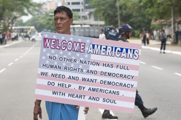 An Obama supporter carries a sign welcoming the US president to Rangoon on Nov. 19. (Photo: Steve Tickner / The Irrawaddy)