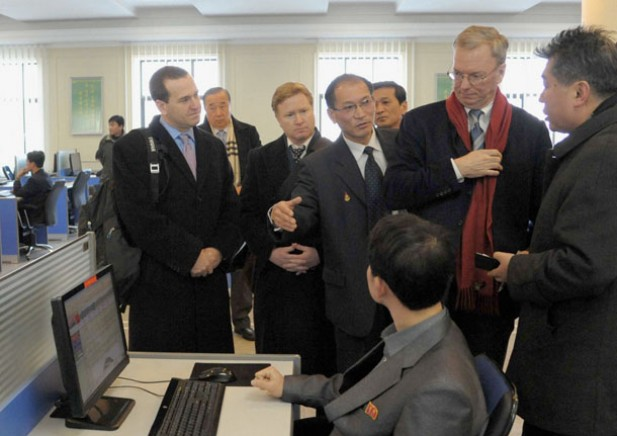 Google Executive Chairman Eric Schmidt, second from right, looks at a student using the Internet with desktop computers as he visits Kim Il-Sung University in Pyongyang on Jan. 8, 2013. North Korea has been accused of using cyber warfare against its critics. (Photo: Reuters / Kyodo)