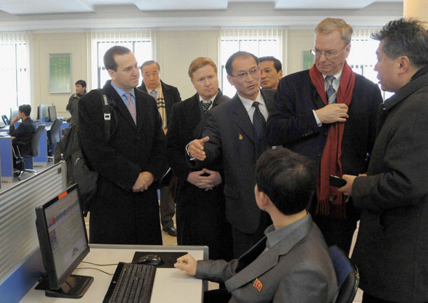 Google Executive Chairman Eric Schmidt, second from right, looks at a student using the Internet with desktop computers as he visits Kim Il-Sung University in Pyongyang on Jan. 8, 2013. (Photo: Reuters / Kyodo)
