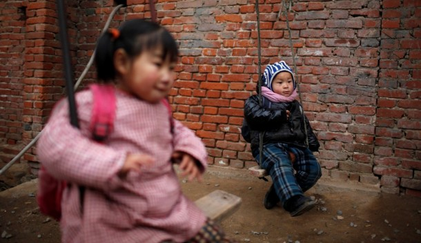 Children play on swings at a kindergarten in Ruzhou county in China's central Henan province Dec. 17, 2012. (Photo: Reuters)