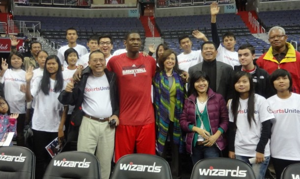 NBA star Bradley Beal of the Washington Wizards poses for a picture with Burma's junior basketball team in Washington on Saturday, together with State Department official Tara Sonenshine and Burma's Ambassador to the US Than Swe. (Photo: Lalit J Kha / The Irrawaddy)