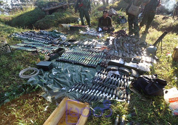 Burmese government troops display weapons seized from the KIA's Point 771 in Lajayang in this photo from the website of the military-owned newspaper Myawaddy. (Photo: Myawaddy)