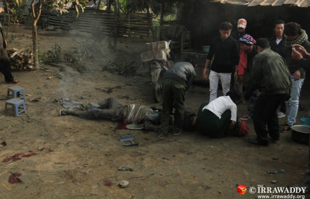 Villagers tend to several people who were hit by a Burma government mortar strike hit Laiza several minutes before. (Photo: Zen Myat Laphai / The Irrawaddy)