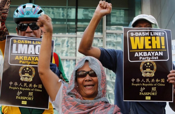 Protesters mock Chinese passports during a rally in front of the Chinese consulate in Manila on Nov. 29, 2012, saying the map in the new passports violates the Philippines' national sovereignty by marking the disputed South China Sea as Chinese territory. (Photo: Reuters)