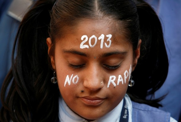 A student prays during a vigil for a gang rape victim, who was assaulted in New Delhi, in Ahmedabad. (Photo: Reuters)