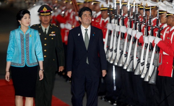 Thai Prime Minister Yingluck Shinawatra, left, and Japan's Prime Minister Shinzo Abe review a guard of honor during a welcoming ceremony in Bangkok on Jan. 17, 2013.