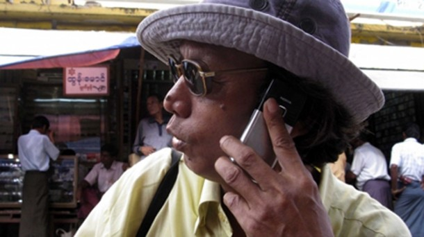 A Burmese man holds a cell phone—an item that is still beyond the reach of many in the country, despite recent economic reforms. (Photo: The Irrawaddy)
