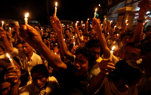 Demonstrators hold a candle-lit protest against power shortages by Rangoon's Sule Pagoda in May 2012. (Photo: Reuters)