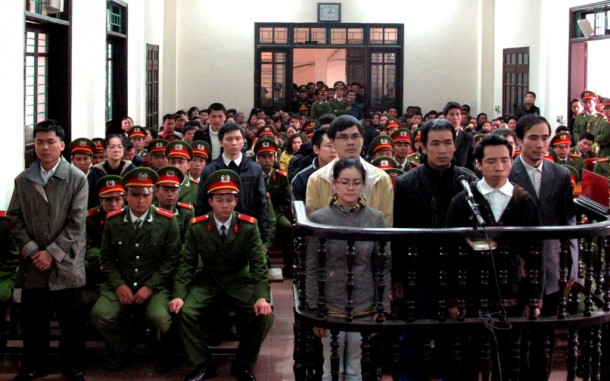 Defendants found guilty of anti-state crimes stand in front of dock at a court in Nghe An Province, about 300 km south of Hanoi, on Jan. 9, 2013. (Photo: Reuters / Vietnam News Agency)