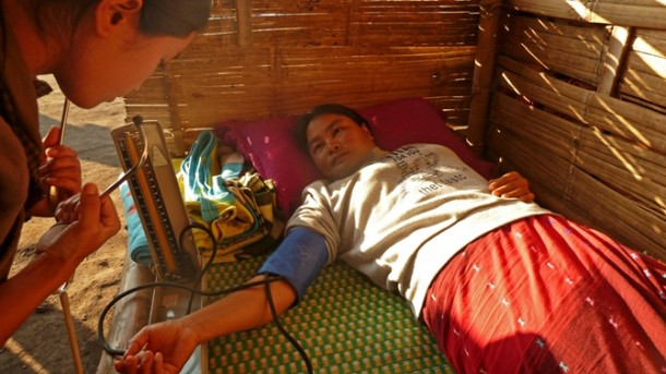A woman receives treatment at an IDP camp outside Laiza in Burma's northern Kachin State early last year. (Photo: IRIN)