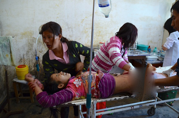 Medics at a hospital in Laiza, Kachin State, tend to Lamong Kailing, who was injured by the Burma Army shelling outside the town last week. (Photo: Simon Roughneen / The Irrawaddy)