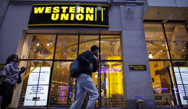 People walk past a Western Union branch at Times Square in New York. The company has begun offering its services to overseas Burmese. (Photo: Reuters)