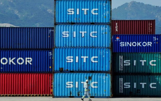 A man walks past shipping containers at the Dayaowan port in Dalian, China. Trade between China and the US has reached record levels, despite growing tensions between the two countries. (Photo: Reuters)