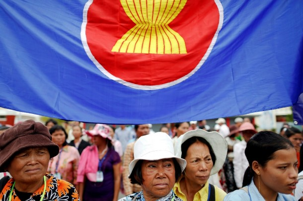 Women stand under the Asean flag as hundreds of protesters call for human rights and democracy ahead of the Asean summit in Phnom Penh, Cambodia, on Nov. 16, 2012. (Photo: Reuters)